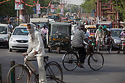 Two man are cycling in the mids of a busy junction in Agra. The Taj Mahal has been struggling to keep in shape also because of the high levels of pollution in the city, mainly caused by congested roads and high levels of traffic, vehicles and an increasing population, in Agra.