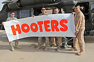 1-244 Air Helicopter Battalion ( part of the 34th Air Brigade) is made up of companies from the Louisiana and Florida National guards. They conduct air assault and air movement operation including acting as a taxi service around  Baghdad flying a ring around the bases before returning to their hub in Balad.  It cost $6000 an hour to operate a blackhawk, so it isn't the most cost effective way to get around but it is the safest. ///Hooters sign SGT. Villa is flying with to bring back to the local Hotters he goes to in Florida when he gets home