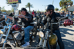 Chris Wade (L) on his custom Panhead and Peter Ballard of New Hampshire leaving Willie's Tropical Tattoo's annual Choppertime Old School bike show during Daytona Bike Week. Daytona Beach, FL. USA. Thursday March 16, 2017. Photography ©2017 Michael Lichter.