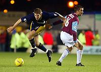 Photograph: Scott Heavey.<br />Wimbledon v West Ham United. Nationwide Division One. 15/11/2003.<br />Ben Chorley skips past Kevin Horlock