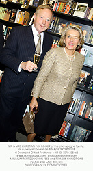 MR & MRS CHRISTIAN POL ROGER of the champagne family, at a party in London on 8th April 2003.	PIS 118