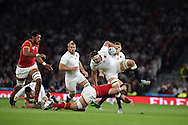 Tom Wood of England is tackled by Dan Lydiate of Wales. Rugby World Cup 2015 pool A match, England v Wales at Twickenham Stadium in London, England  on Saturday 26th September 2015.<br /> pic by  Andrew Orchard, Andrew Orchard sports photography.