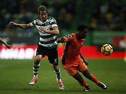 December 17, 2017 - Lisbon, Portugal - Sporting's defender Fabio Coentrao (L) vies for the ball with Portimonense's forward Wilson Manafa (R)  during Primeira Liga 2017/18 match between Sporting CP vs Portimonense SC, in Lisbon, on December 17, 2017. (Credit Image: © Carlos Palma/NurPhoto via ZUMA Press)