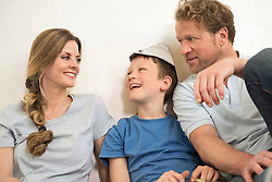 Smiling happy young family together sitting