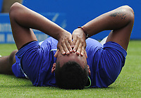 Tennis - 2017 Aegon Championships [Queen's Club Championship] - Day One, Monday<br /> <br /> Men's Singles, Round of 32<br /> Nick Kyrgios [Aus] vs. Donald Young [USA]<br /> <br /> Nick Kyrgios feels the pain after falling over on Centre Court.<br /> <br /> COLORSPORT/ANDREW COWIE