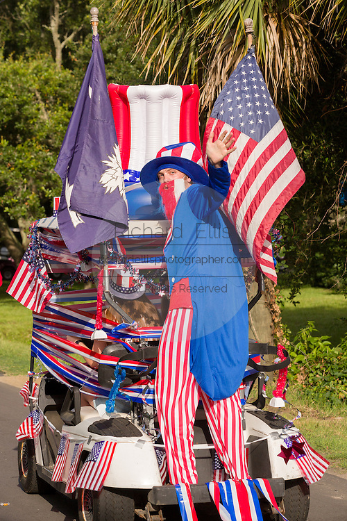 Uncle Sam waves from the back of a golf cart decorated with bunting and American flags during the Sullivan's Island Independence Day parade July 4, 2015 in Sullivan's Island, South Carolina.