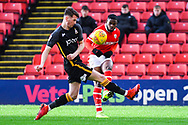 Mamadou Thiam of Barnsley (26) crosses the ball under pressure from Paudie O'Connor of Bradford City (5) during the EFL Sky Bet League 1 match between Barnsley and Bradford City at Oakwell, Barnsley, England on 12 January 2019.