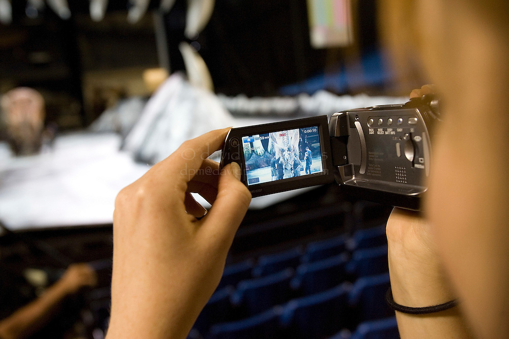 """TACOMA, WA - JULY 13: A reporter films during a rehearsal check before a performance of """"Walking WIth Dinosaurs"""" on July 13, 2007 at the Tacoma Dome in Tacoma, Washington.  (Photo by David Paul Morris)"""