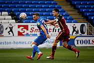 Peterborough United forward Matt Godden (9) and Bradford City defender Anthony O'Connor (6)  during  the The FA Cup 2nd round match between Peterborough United and Bradford City at London Road, Peterborough, England on 1 December 2018.
