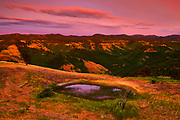 The hills of the Blue Mountains in Columbia County, Washington, are bathed in golden light after sunset. The Blue Mountains are named for their apparent color when viewed during the day at a distance. Most of the mountain range extends into Oregon and its river valleys and lower levels were occupied by indigenous peoples for thousands of years.