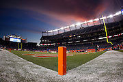 The sky turns pink and blue as the sun sets over Sports Authority Field at Mile High in this general view photo of the stadium interior taken prior to the Denver Broncos NFL week 11 football game against the New York Jets on Thursday, November 17, 2011 in Denver, Colorado. The Broncos won the game 17-13. ©Paul Anthony Spinelli