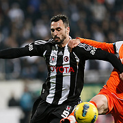 Besiktas's Hugo Almedia (L) and IBBSpor's Rizvan Sahin (R) during their Turkish superleague soccer match Besiktas between IBBSpor at BJK Inonu Stadium in Istanbul Turkey on Sunday, 11 December 2011. Photo by TURKPIX