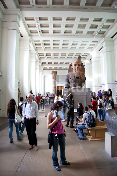 The British Museum, London. The ancient Egyptian sculpture room. Artifacts from Egypt on display including (here) Pharaoh Rameses II.