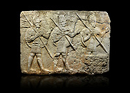 Hittite monumental relief sculpted orthostat stone panel from the Herald's Wall. Basalt, Karkamıs, (Kargamıs), Carchemish (Karkemish), 900-700 B.C. Military parade. Anatolian Civilisations Museum, Ankara, Turkey. Two helmeted soldiers in short skirts carry the shield on their backs and the spears in their hands.  <br /> <br /> Against a black background. .<br />  <br /> If you prefer to buy from our ALAMY STOCK LIBRARY page at https://www.alamy.com/portfolio/paul-williams-funkystock - Scroll down and type - Hittite art Carchemish - into LOWER search box. (TIP - Refine search by adding  or background colour as well).<br /> <br /> Visit our HITTITE PHOTO COLLECTIONS for more photos to download or buy as wall art prints https://funkystock.photoshelter.com/gallery-collection/The-Hittites-Art-Artefacts-Antiquities-Historic-Sites-Pictures-Images-of/C0000NUBSMhSc3Oo