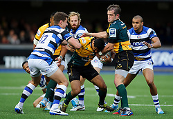 Northampton Winger Ken Pisi is tackled by Bath Inside Centre Ollie Devoto - mandatory by-line: Rogan Thomson/JMP - Tel: 07966 386802 - 23/05/2014 - SPORT - RUGBY UNION - Cardiff Arms Park, Wales - Bath Rugby v Northampton Saints - Amlin Challenge Cup Final.