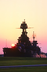 Stock photo of the Battleship Texas docked at San Jacinto State Park in the Houston Ship Channel at Sunset