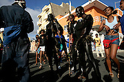 """In Carnival parades in Mindelo, attempts to recover the tradition of """"mandigas"""" groups are made. These were members of African groups also used as slaves in Cape Verde. They rumble the streets chaotically playing with the audience and covered with oil or mud. They are generally from the poorer strata of population."""