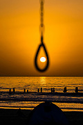 Setting sun as seen through a noose Photographed over the Mediterranean Sea, Israel