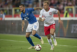 October 14, 2018 - Chorzow, Poland - Christiano Biraghi of Italy and Kamil Grosicki of Poland during the UEFA Nations League A match between Poland and Italy at Silesian Stadium in Chorzow, Poland on October 14, 2018  (Credit Image: © Andrew Surma/NurPhoto via ZUMA Press)
