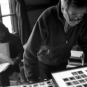 Bill Eppridge, front, and Larry Armstrong, rear left, edit student's images.