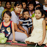 Children sitting at a kindergaten at a pagoda in mandalay