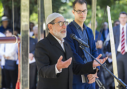 March 24, 2019 - Christchurch, Canterbury, New Zealand - Imam Ibrahim AbdulHalim of the Linwood mosque addresses a crowd at an interfaith service at the Peace Bell in the Botanic Gardens. Some 24 different faiths were represented at the service, with the Peace Bell sounding 50 times in memory of those killed at the Al Noor and Linwood mosques on 15 March. (Credit Image: © PJ Heller/ZUMA Wire)