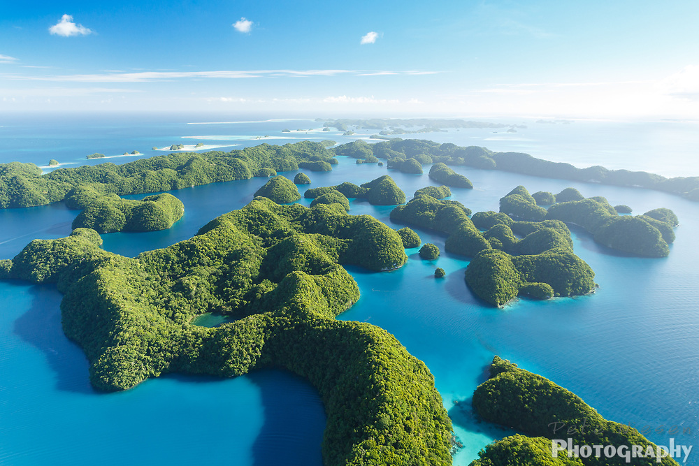 Aerial view of a lush tropical island atoll in the turquoise blue waters of the south pacific