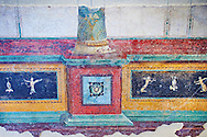 """Roman fresco wall decorations of cryptoporticus A  of the Villa Farnesia, Rome. Museo Nazionale Romano ( National Roman Museum), Rome, Italy.<br /> <br /> The paintings in the long corridor, which got light only from small high-placed windows, are on a white background. The illusionistic decoration shows a row of columns on a high socle decorated with """"grottesche"""". In the background, pictures alternating theatrical scenes, scenes of worship, and landscapes seem to hang on a wall divided by pilasters. Some of the scenes are probably later restorations of the originals. <br /> In the upper part a loggia holding sphinxes and statues of divinities rests on caryatids (architectural supports in the form of female figures). <br /> Because there was limited time for excavation, only the more important decorative elements were removed from the walls. A drawing on the modern base on which the fragments are inserted gives an idea of the effect of the whole, which is known to us from a watercolor done at the time. .<br /> <br /> If you prefer to buy from our ALAMY PHOTO LIBRARY  Collection visit : https://www.alamy.com/portfolio/paul-williams-funkystock/national-roman-museum-rome-fresco.html<br /> <br /> Visit our ROMAN ART & HISTORIC SITES PHOTO COLLECTIONS for more photos to download or buy as wall art prints https://funkystock.photoshelter.com/gallery-collection/The-Romans-Art-Artefacts-Antiquities-Historic-Sites-Pictures-Images/C0000r2uLJJo9_s0"""