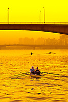 Egyptian women sculling on the Nile River in Cairo, Egypt at sunrise