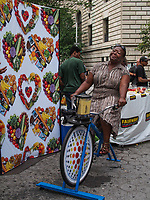 Bystanders pedal a blender-bike for free fruit smoothies on the Upper Westside of Manhattan, courtesy of Fairway Market.