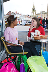 Young women relax in a café after a hard day shopping; Mansfield; Nottinghamshire,