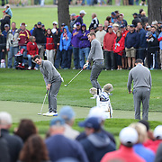 Ryder Cup 2016. Rory McIlroy of Europe and his team mates mates practicing on the seventeenth during practice day in front of massive crowds at the Hazeltine National Golf Club on September 28, 2016 in Chaska, Minnesota.  (Photo by Tim Clayton/Corbis via Getty Images)