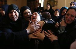 April 13, 2018 - Khan Yunis, Gaza Strip, Palestinian Territory - Palestinian women mourn during the funeral of Abdullah al-Shahari, 28, who was killed by Israeli security forces during clashes at the Israel-Gaza border the previous day, in Khan Yunis, in southern Gaza Strip.   (Credit Image: © Ashraf Amra/APA Images via ZUMA Wire)