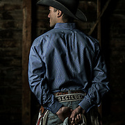 UVU Rodeo team member Caleb Bennett pose for photos in a barn on the farm of Robert Taylor in Provo, Utah Tuesday April 9, 2013. (August Miller)