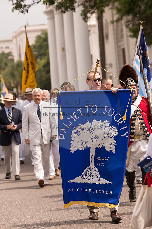 Members of the Palmetto Society march down Meeting Street to celebrate Carolina Day June 28, 2014 in Charleston, SC. Carolina Day celebrates the 238th anniversary of the American victory at the Battle of Sullivan's Island over the Royal Navy and the British Army.