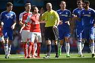 Referee Michael  Dean trying to calm the situation with both sets of players after incident. Barclays Premier League match, Chelsea v Arsenal at Stamford Bridge in London on Saturday 19th September 2015.<br /> pic by John Patrick Fletcher, Andrew Orchard sports photography.