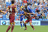 Cardiff City's Frederic Gounongbe  climbs on QPR's Massimo Luongo (21) to win a header. EFL Skybet championship match, Cardiff city v Queens Park Rangers at the Cardiff city stadium in Cardiff, South Wales on Sunday 14th August 2016.<br /> pic by Carl Robertson, Andrew Orchard sports photography.