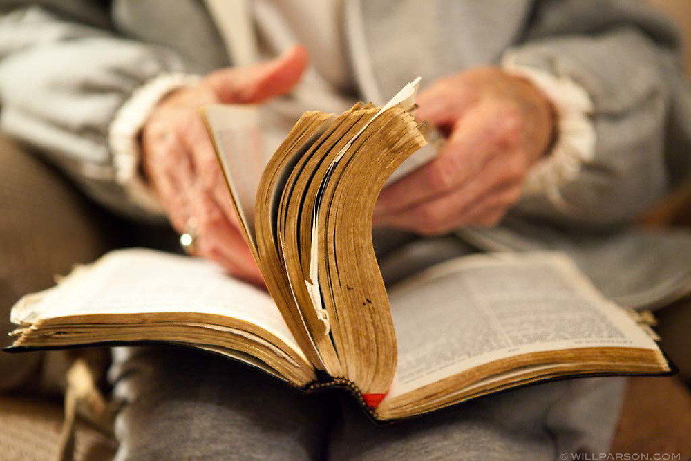 Thelma Trout, 97, leafs through her Bible at her home in Coolville, Ohio. Trout, who does not drive, had to switch congregations 7 years ago when her husband Richard passed away. Her new church offers a bus that picks up Trout in her driveway.