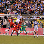 EAST RUTHERFORD, NEW JERSEY - JUNE 26: Ramiro Funes Mori #13 of Argentina challenges for a cross with Arturo Vidal #8 of Chile and Gary Medel #17 of Chile during the Argentina Vs Chile Final match of the Copa America Centenario USA 2016 Tournament at MetLife Stadium on June 26, 2016 in East Rutherford, New Jersey. (Photo by Tim Clayton/Corbis via Getty Images)