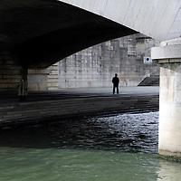 Europe, France, Paris. Under a bridge along the Seine Embankment.