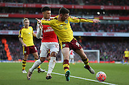 David Jones of Burnley blocks the ball from Alex Oxlade-Chamberlain of Arsenal. The Emirates FA cup, 4th round match, Arsenal v Burnley at the Emirates Stadium in London on Saturday 30th January 2016.<br /> pic by John Patrick Fletcher, Andrew Orchard sports photography.