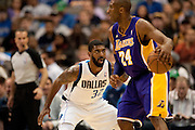 O.J. Mayo (32) of the Dallas Mavericks defends against Kobe Bryant (24) of the Los Angeles Lakers at the American Airlines Center in Dallas on Sunday, February 24, 2013. (Cooper Neill/The Dallas Morning News)