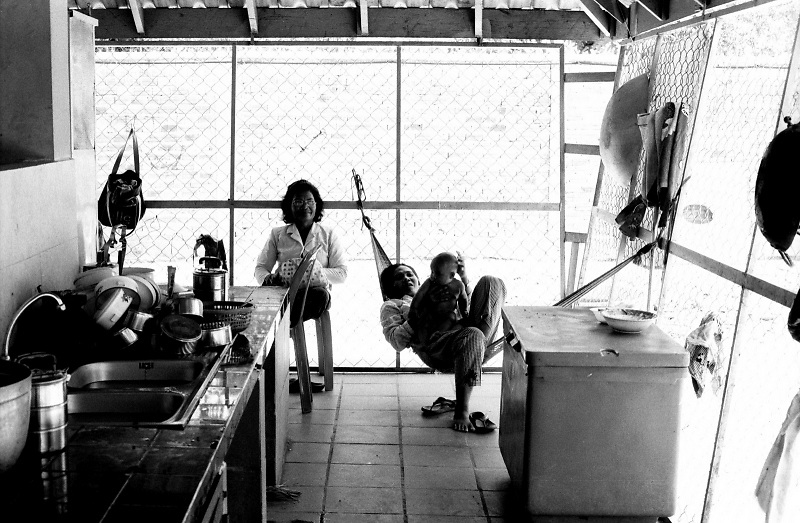 Two women and a baby relaxing in a shelter attached to the Cambodian Landmine Museum in the outskirts of Siem Reap, Cambodia.