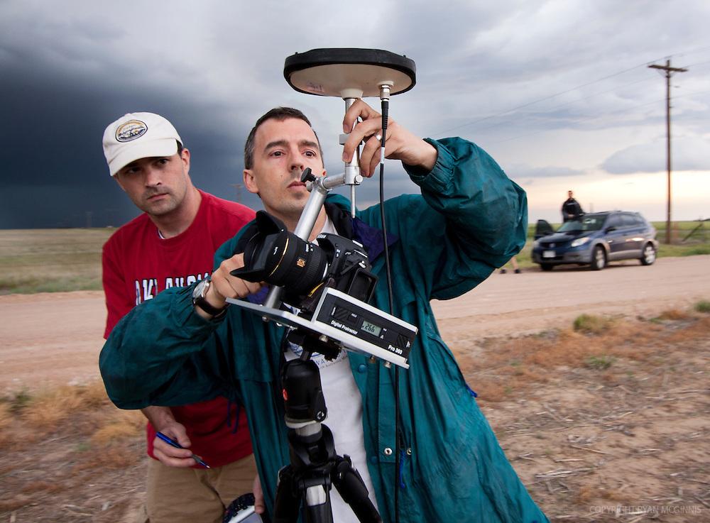 Scientists set up a photogrammetry system near Arriba, Colorado, June 11, 2010.