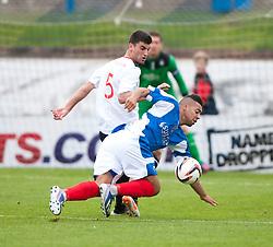Falkirk's Jonathan Flynn and Cowdenbeath's Kane Hemmings.<br /> Cowdenbeath 1 v 0 Falkirk, 14/9/2013.<br /> ©Michael Schofield.