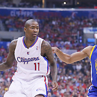 21 April 2014: Los Angeles Clippers guard Jamal Crawford (11) drives past Golden State Warriors forward Andre Iguodala (9) during the Los Angeles Clippers 138-98 victory over the Golden State Warriors, during Game Two of the Western Conference Quarterfinals of the NBA Playoffs, at the Staples Center, Los Angeles, California, USA.