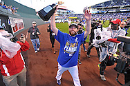 Oct 15, 2014; Kansas City, MO, USA; Kansas City Royals relief pitcher Greg Holland holds up the American League championship trophy for fans after game four of the 2014 ALCS playoff baseball game against the Baltimore Orioles at Kauffman Stadium. The Royals swept the Orioles to advance to the World Series. Mandatory Credit: Peter G. Aiken-USA TODAY Sports