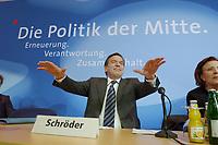 13 MAY 2002, BERLIN/GERMANY:<br /> Gerhard Schroeder, SPD, Bundeskanzler, versucht den Applaus zu daempfen, vor Beginn der SPD Parteikonferenz, links: Heidemarie Wieczorek-Zeul, Bundesentwicklungshilfeministerin, Willi-Brandt-Haus<br /> IMAGE: 20020513-03-010<br /> KEYWORDS: Gerhard Schröder, Schriftzug, Die Politik der Mitte