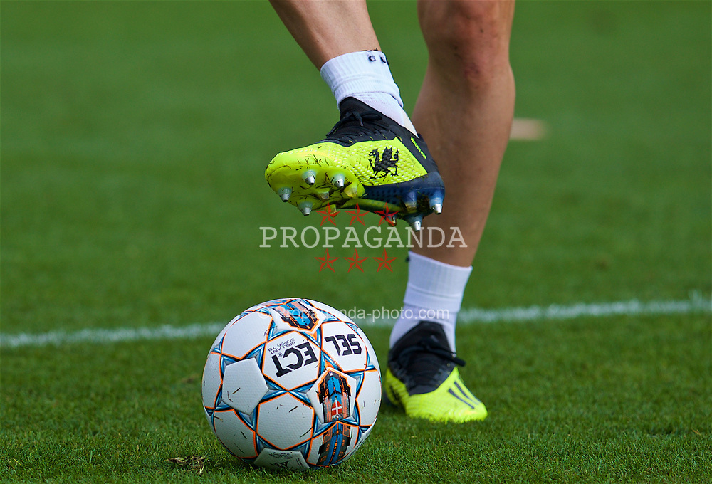 CARDIFF, WALES - Saturday, September 8, 2018: The yellow Adidas boots of Wales' Gareth Bale featuring a black dragon during a training session at the Vale Resort ahead of the UEFA Nations League Group Stage League B Group 4 match between Denmark and Wales. (Pic by David Rawcliffe/Propaganda)
