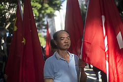 July 1, 2017 - Hong Kong, Hong Kong - Pro-democracy protesters chanted slogans at a rally to protest against the flag raising ceremony in Hong Kong. On the other side, pro-Beijing protesters hold flag of China to stop the pro-democracy protesters coinciding with the flag raising ceremony. (Credit Image: © Hei Chan  Reportage/Pacific Press via ZUMA Wire)